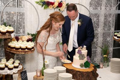 Vermont Wedding Couple cutting wedding cake.